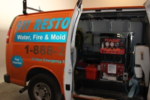 Water Damage Restoration Vacuum Van At Job Location