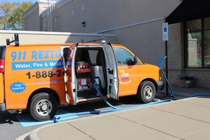 Water Damage Restoration Van AT Exterior Of Job Location