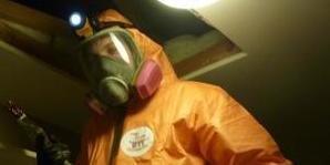 Water Damage Restoration Technician In Mold Cleanup Gear